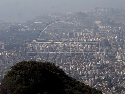 A view of the Tijuca area of Rio, including the Maracana Stadium, from the Tijuca Forest National Park in Rio de Janeiro. The park, a forested mountain surrounded by an intensely populated urban area, is a model of preservation of the Brazil's Atlantic Forest ecosystem, of which only 7% remains. It is allegedly the largest urban forest in the world, and declared a National Park in 1961. Formerly a coffee planting area and Rio's water source, Brazilian Emperor Dom Pedro II had the area completely reforested in the 1860s as the city's water supply began to dwindle. It is home to hundreds of species of plants and wildlife, many threatened by extinction (Australfoto/Douglas Engle)