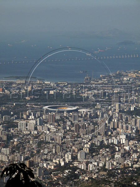 A view of Rio's north side, and the Maracana stadium, from the Tijuca Forest National Park in Rio de Janeiro. The park, a forested mountain surrounded by an intensely populated urban area, is a model of preservation of the Brazil's Atlantic Forest ecosystem, of which only 7% remains. It is allegedly the largest urban forest in the world, and declared a National Park in 1961.  Formerly a coffee planting area and Rio's water source, Brazilian Emperor Dom Pedro II had the area completely reforested in the 1860s as the city's water supply began to dwindle. It is home to hundreds of species of plants and wildlife, many threatened by extinction (Australfoto/Douglas Engle)