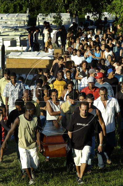 Friends and family of massacre victim Douglas Brasil da Paula, carry his coffin during his funeral at a cemetery in Nova Iguacu, Brazil, on Friday, April 1, 2005. In what was described as a 'massacre' and 'bloodbath', gunmen murdered at least 28 people in three separate killings in the outskirts of Rio de Janeiro, officials said Friday. The killings, which occurred late Thursday night in Nova Iguacu and Queimados, two poverty-ridden and crime-infested suburbs, 35 kilometers (22 miles)northwest of Rio de Janeiro, could have been the work of police officers,(AustralFoto/Douglas Engle)