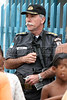 Rio de Janeiro State Police Commander for the Rio metropolitan area Antonio Carlos Suarez David appears in the Vigario Geral favela, or slum, in Rio de Janeiro, Brazil, Dec. 15, 2005. Police occupied the slum after eight young people were kidnapped from there, allegedly by drug traffickers from a rival slum nearby. The kidnappings are the latest episode in a feud between the two slums run by drug traffickers from rival drug gangs, which has been going on for more that 20 years. The Vigario Geral slum was also site of an infamous massacre in 1993, in which police killed 21 people. Shootouts marked by indiscriminate shooting between rival drug gangs and the police are common in Rio and innocent bystanders have fallen victim to the deadly gunfire and the homicide rate of Rio rivals that of declared war zones.(AustralFoto/Douglas Engle)