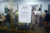 """A sign at the emergency room entrance warn of limited capacity at the Bonsucesso Hospital in Rio de Janeiro, Jan 21, 2005. The sign reads """"Attention, emergency room capacity is limited to overcrowding (risk of death)."""" Shootouts marked by indiscriminate shooting between rival drug gangs and the police are common in Rio and innocent bystanders have fallen victim to the deadly gunfire. Situated in the working class north side of Rio, and close to two notorious slum complexes, the hospital personelle has earned a reputation as expert on gunshot wounds. The homicide rate of 8,408 in 1994 (about 23 per day) rivals that of declared war zones.(AustralFoto/Douglas Engle)"""