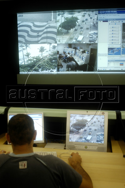 Police agents monitor video feeds at the Rio de Janeiro state Security Command and Control Center in Rio de Janeiro, Jan. 24, 2005. Images from urban security cameras are projected on computer screens at the high-tech center, allowing police agents to monitor and identify crimes. Emergency calls are received and police cars are tracked via satelite at the center and the combination has reduced the response times to crimes say police officials. The center is a new attempt to curb Rio's notorious crime rate and corrupt police.(AustralFoto/Douglas Engle)