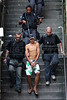 Rio de janeiro State Police Police (PMERJ) escort a prisoner down a stairway from a slum where a shootout took place about 3 hours earlier in Rio de Janeiro, Brazil, Oct. 21, 2009. (Douglas Engle/Australfoto)