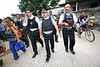 Rio de Janeiro State Police commander Hudson de Aguiar Miranda, center, walks with Rio de Janeiro Civil Police Chief Alvaro Lins, to his left, as they tour the Vigario Geral favela, or slum, in Rio de Janeiro, Brazil, Dec. 15, 2005. Police occupied the slum after eight young people were kidnapped from there, allegedly by drug traffickers from a rival slum nearby. The kidnappings are the latest episode in a feud between the two slums run by drug traffickers from rival drug gangs, which has been going on for more that 20 years. The Vigario Geral slum was also site of an infamous massacre in 1993, in which police killed 21 people. Shootouts marked by indiscriminate shooting between rival drug gangs and the police are common in Rio and innocent bystanders have fallen victim to the deadly gunfire and the homicide rate of Rio rivals that of declared war zones.(AustralFoto/Douglas Engle)