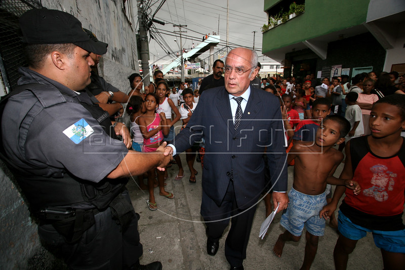 Deputy Security Secretary for Security Rio de Janeiro state, Paulo Souto arrives in the Vigario Geral favela, or slum, in Rio de Janeiro, Brazil, Dec. 15, 2005. Souto was there to help investigate the kidnappings of eight young people from there, allegedly by drug traffickers from a rival slum nearby. The kidnappings are the latest episode in a feud between the two slums run by drug traffickers from rival drug gangs, which has been going on for more that 20 years. The Vigario Geral slum was also site of an infamous massacre in 1993, in which police killed 21 people. Shootouts marked by indiscriminate shooting between rival drug gangs and the police are common in Rio and innocent bystanders have fallen victim to the deadly gunfire and the homicide rate of Rio rivals that of declared war zones.(AustralFoto/Douglas Engle)