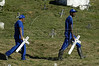 Cemetery workers carry crosses to graves at the Nova Iguacu, cemetery in Nova Iguacu, Brazil, Friday, April 1, 2005. In what was described as a 'massacre' and 'bloodbath', gunmen murdered at least 28 people in three separate killings in the outskirts of Rio de Janeiro, officials said Friday. The killings, which occurred late Thursday night in Nova Iguacu and Queimados, two poverty-ridden and crime-infested suburbs, 35 kilometers (22 miles)northwest of Rio de Janeiro, could have been the work of police officers,(AustralFoto/Douglas Engle)