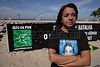 Cleyde Padro Maia stands near an antiviolence protest on copacabana beach in Rio de Janeiro, August 4, 2007. Maia is mother of Gabriela do Prado Ribeiro, killed by a stray bullet in a shootout March 25, 2003. Maia has become a spokesperson for tougher penalties for convicted criminals. Organizers said that more than 3,000 people have been killed by firearms in Rio from January through July, 2007.(Australfoto/Douglas Engle)