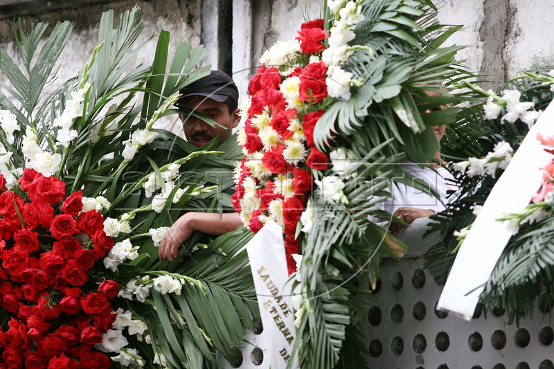 Family, friends and supporters of Erismar Rodrigues Moreira, known as Bem-Te-Vi, attend his funeral at a cemetery of Rio de Janeiro, Brazil, Oct. 29, 2005. Bem-Te-Vi, nicknamed after a common bird in Brazil, was one of the most wanted drug traffickers and killed during a shootout with police in the Rocinha slum Oct. 28. The police celebrated the event as a victory in the on-going drug war in the city. About 20 percent of the residents of Rio live in slums and the drug trade is a viable option for work for people with few resources. Police have a virtual mandate from the government and population in general to deal with traffickers the way the see fit. The murder rate of Rio rivals that of declared war zones. With 100 million fewer citizens than the United States, Brazil has 25 percent more gun deaths at about 36,000, officially recorded, per year (about 98 per day).(AustralFoto/Douglas Engle)
