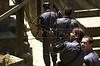 Rio de Janeiro State military Police (PMERJ) officers patrol in a Rio de Janeiro favela or slum.(Douglas Engle/Australfoto)
