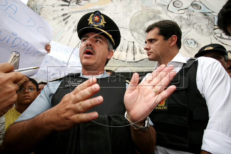 Rio de Janeiro State Police commander Hudson de Aguiar Miranda talks to the press as Rio de Janeiro Civil Police Chief Alvaro Lins, right listens in the Vigario Geral favela, or slum, in Rio de Janeiro, Brazil, Dec. 15, 2005. Police occupied the slum after eight young people were kidnapped from there, allegedly by drug traffickers from a rival slum nearby. The kidnappings are the latest episode in a feud between the two slums run by drug traffickers from rival drug gangs, which has been going on for more that 20 years. The Vigario Geral slum was also site of an infamous massacre in 1993, in which police killed 21 people. Shootouts marked by indiscriminate shooting between rival drug gangs and the police are common in Rio and innocent bystanders have fallen victim to the deadly gunfire and the homicide rate of Rio rivals that of declared war zones.(AustralFoto/Douglas Engle)