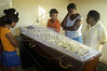 Friends and family of a massacre victim pay last respects before several funerals at a cemetery in Nova Iguazu, Brazil, on Friday, April 1, 2005. In what was described as a 'massacre' and 'bloodbath', gunmen murdered at least 28 people in three separate killings in the outskirts of Rio de Janeiro, officials said Friday. The killings, which occurred late Thursday night in Nova Iguacu and Queimados, two poverty-ridden and crime-infested suburbs, 35 kilometers (22 miles)northwest of Rio de Janeiro, could have been the work of police officers,(AustralFoto/Douglas Engle)
