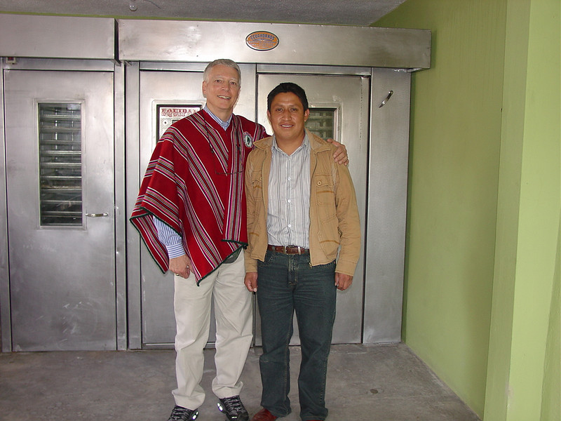Paul and David celebrate the opening of the bakery. Behind are the new warming and baking ovens.