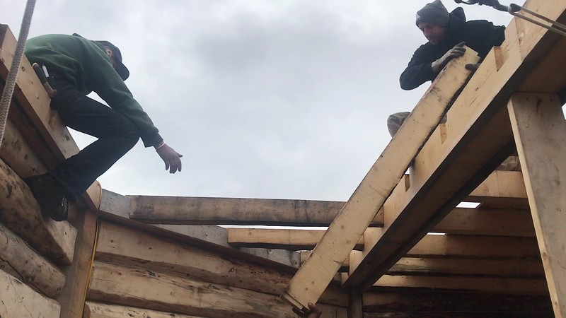 """These second-floor joists were built with our friends, Lee and Tim, this past June. Hearing the satisfying """"thunk"""" was an important part of the building process. Now, three months later, after a summer of the joist pieces sitting outside in all kinds of weather, we are still enjoying a good solid fit as these pieces go up, one by one."""