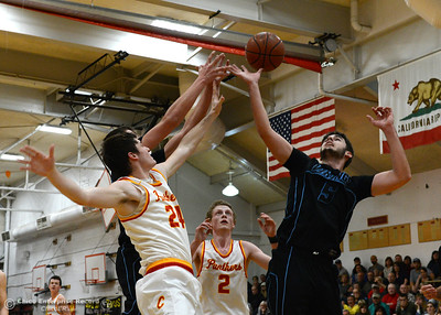 Chico's Ty Thomas (24) and Brendan Bohannon (2) go for a rebound against Pleasant Valley's Kevin Kremer (behind Thomas) and Kyle Lindquist (5) as the Chico High boys basketball team hosts Pleasant Valley in a cross-town rivalry Friday, Feb. 10,2017, in Chico, California. (Dan Reidel -- Enterprise-Record)