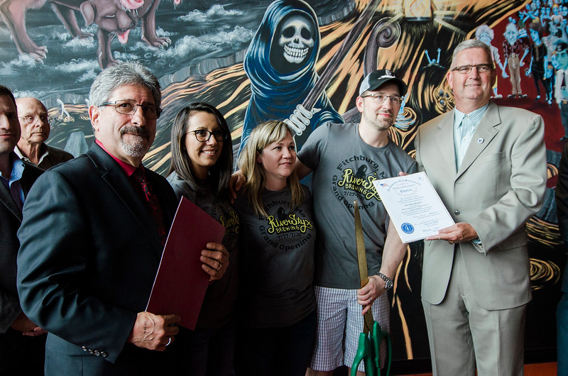 Mayor Stephen DiNatale and State Rep. Stephan Hay present citations to owners Jackie and Scott Cullen, along with their daughter Desiree Moreno as River Styx Brewing in Fitchburg held their grand opening and ribbon cutting on Thursday, July 27, 2017. SENTINEL & ENTERPRISE / Ashley Green