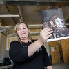Jackie Cullen shows off ideas for hanging lanterns from the ceiling of River Styx Brewing, a new brewery set to open next year on Boulder Dr. in Fitchburg. SENTINEL & ENTERPRISE / Ashley Green