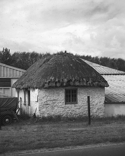 <font size=3><u> - Thatched boat shed - </u></font> (BS0605)  Beasley's cottage, later Frank Young's winter boat shed, about to be demolished (photo taken in May 1962).  The familiar present day boat sheds are visible behind it.