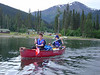 "After spending a night at Dease Crossing campground, we started the trip by crossing Joe Irwin Lake . Here are Karol and Andrew, paddling their own canoe. <br /> If  you click on ""map this"" above this photo, you will be able to access a map of the area."
