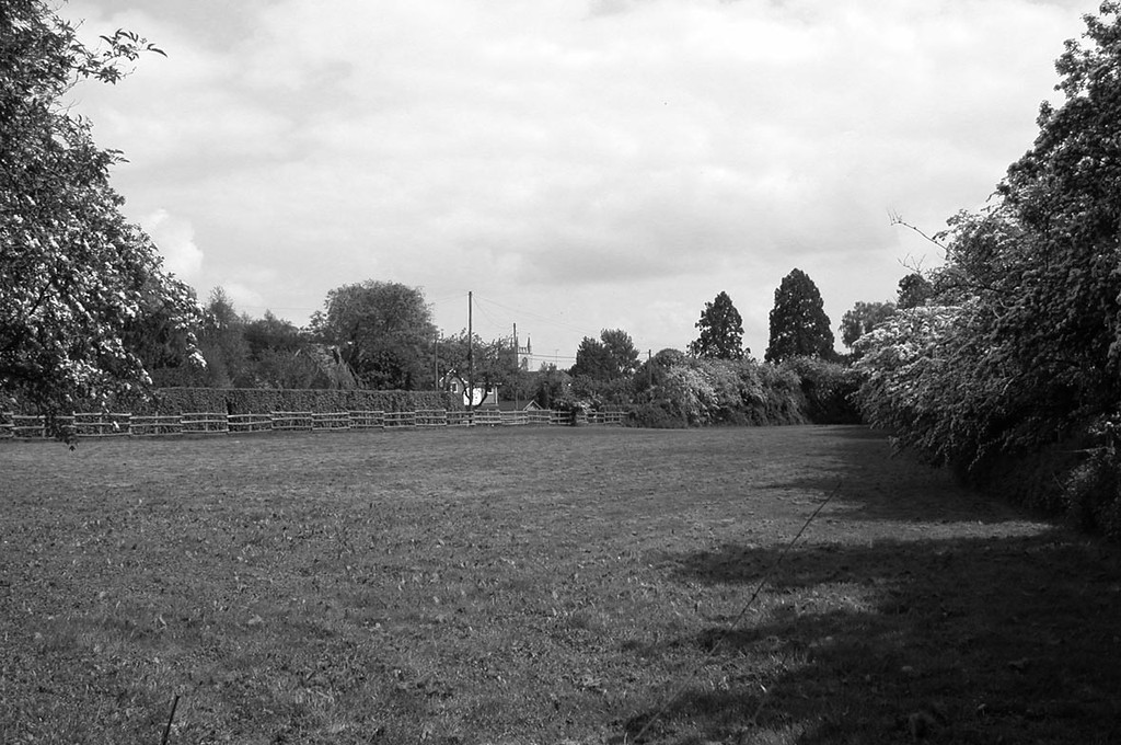 <center><font size=3><u> - River meadows - </u></font> (BS0963)  Today only the field to the south-east of Gurney's Garage (shown here) and the water meadows to the north-east of of the River Camping site remain of the former landscape.  (see also BS0962)