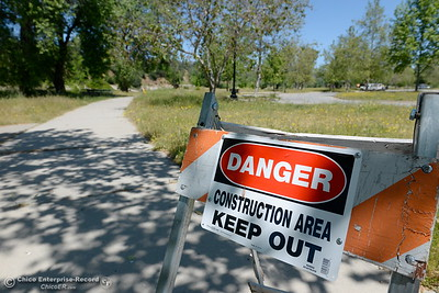 Danger signs are found throughout the park while Riverbend Park remains closed as construction is underway on repairs to the park in Oroville, Calif. Wednesday May 2. 2018. (Bill Husa -- Enterprise-Record)