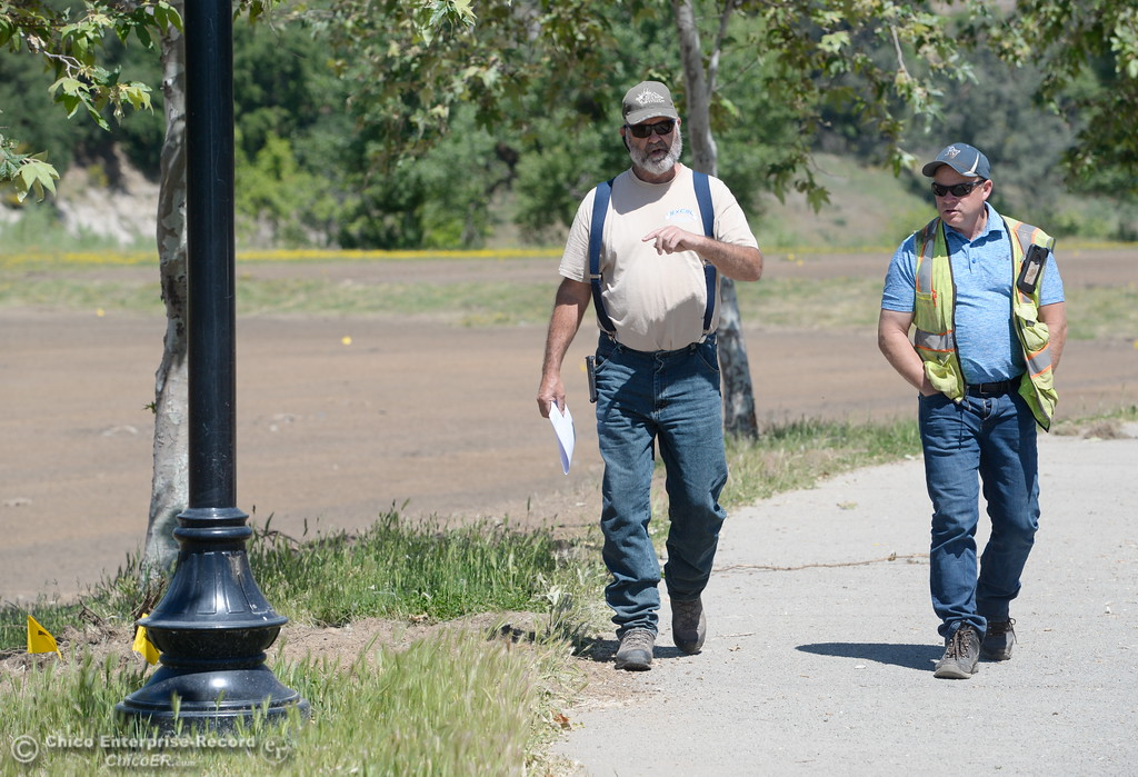 . Lee Ward of Ward\'s concrete left and Brandon Duntsch with Franklin Construction walk as they talk while Riverbend Park remains closed as construction is underway on repairs to the park in Oroville, Calif. Wednesday May 2. 2018. (Bill Husa -- Enterprise-Record)
