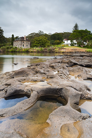 Historic Stone Store and Kemp House stand beside Kerikeri River and basalt river bed, Kerikeri, Northland