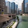 Chicago River riverwalk walkers walking riverfront summer