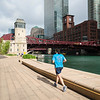 runner running jogging healthy fitness on Riverwalk summer