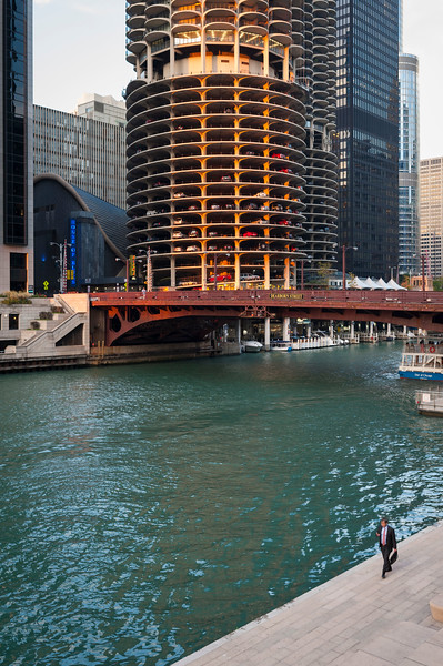 Businessman male walking Chicago Riverwalk Marina City