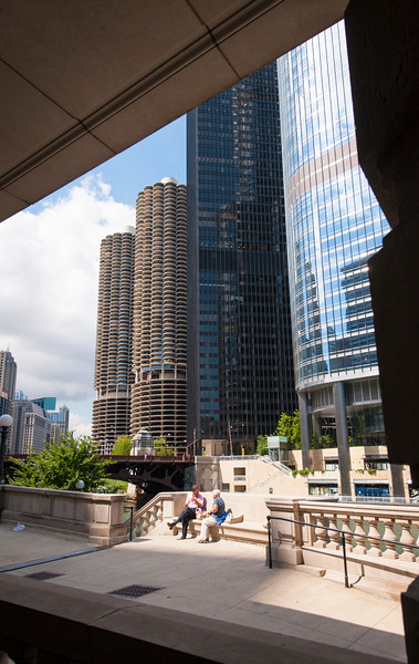 Residents eating lunch on Chicago River riverwalk with skyscrapers architecture background summer