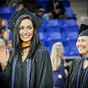 At left, Jessica Withey waves to her family while entering the Rivier Graduation Ceremony. SUN/Caley McGuane