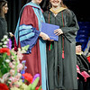At left, Sister Paula Marie Buley hands out degrees to graduates such as biology major, Danielle Lauren Moran. SUN/Caley McGuane