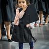 Tanishka Bagel, 3, holds Maheshwari Shambu's graduation cap while she waits to be called on stage. SUN/Caley McGuane