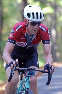 Max Fryar (409) rides on Skyuka Mountain Rd. in the Gran Fondo Hincapie Greenville -- Saturday, October 24, 2020