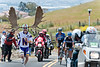 Antler man runs with the chase group of Rory Sutherland, Ryder Hjesdal, Andy Schleck, and Levi Leipheimer