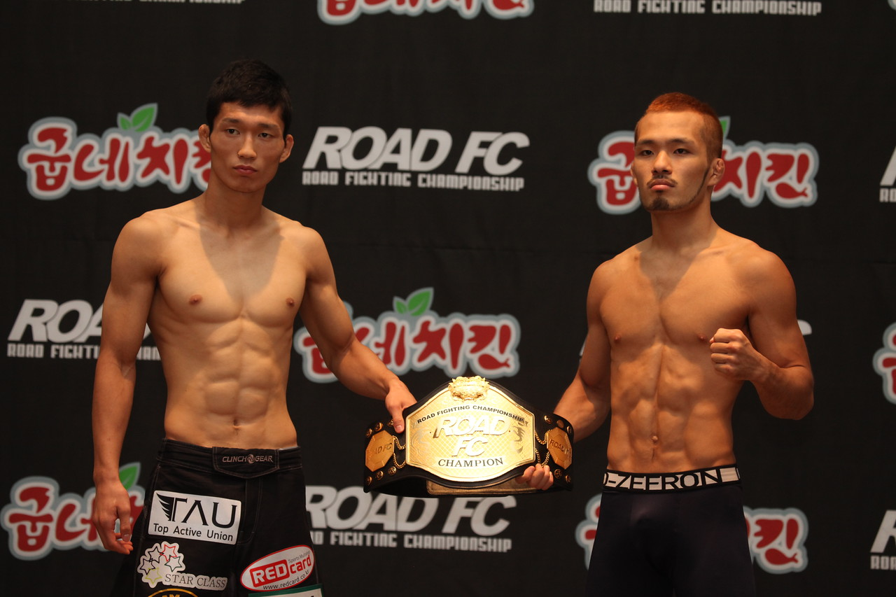 Song Min-Jong and Jo Nam-Jin hold the Flyweight Belt