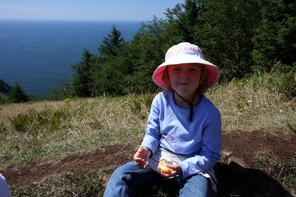 Paige stopping for a snack along the Cascade Head trail.