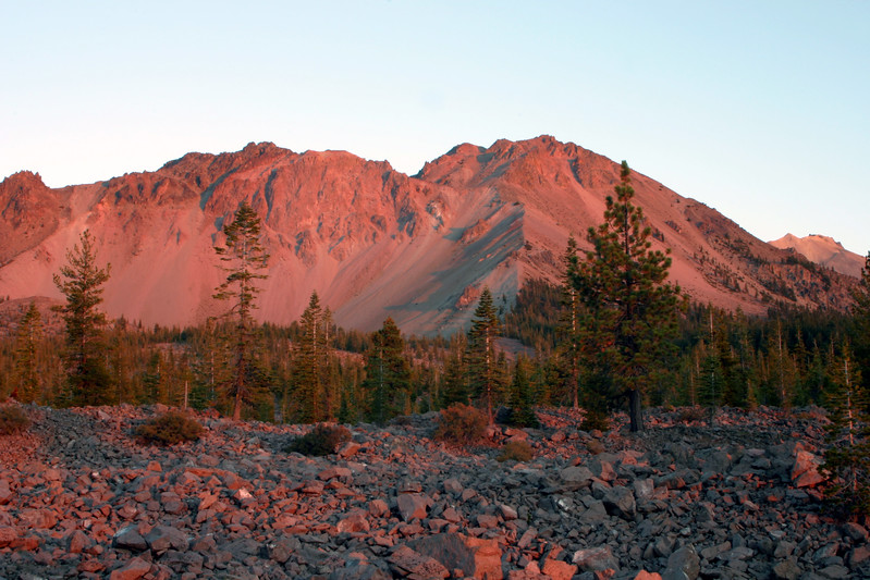 We had just pulled into Lassen Volcanic National Park and were driving towards a campground when we noticed the pink and red sunset illuminating Mt Lassen. We quickly pulled over to grab this picture before the last minutes of light went away. Mt Lassen is part of the Cascade range and last erupted in 1915. The area is still quite active, and there are lots of volcanic features to explore within the park.