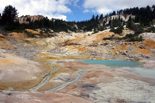 Bumpass Hell in Lassen Volcanic National Park. Colorful and smelly, this is one of the most active volcanic areas in the contintental US. There are boiling pools, boiling mudpots, and sulfur deposits all in this small area that's only a 2 mile hike from the road.