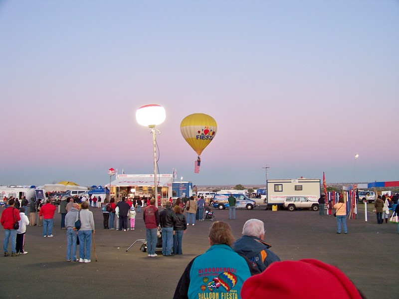 "Launch starts at about 7:00 AM , led by a balloon flying the American flag to the strains of ""The Star Spangled Banner."""