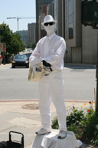 Downtown Ashville, NC - the white man who sttod so still that you couldn't tell if he was real.
