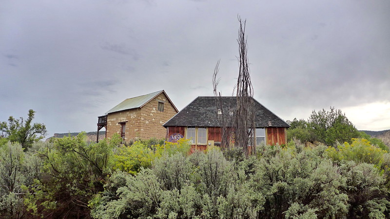 The building at rear is part of the old homestead near Escalante, Utah.