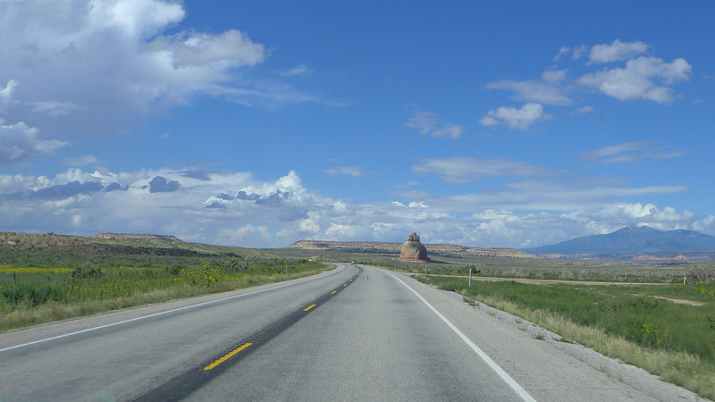 Church Rock as seen from Highway 191 in Utah. The La Sal Mountains are on the left.