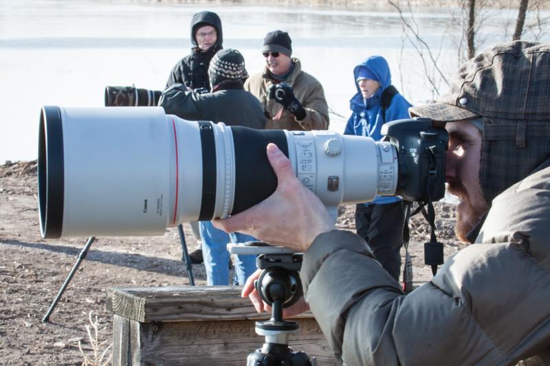 Ryan Kirkpatrick focusing big lens  Photo by Al Ludwick