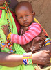 Baby in Masai village.  Photo by Leah Bensen