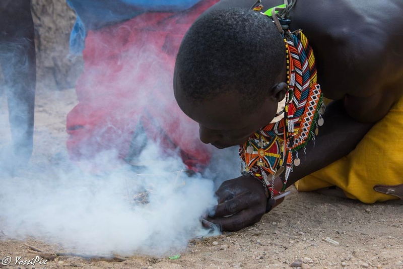 Samburu Village man started a fire without matches. Photo by Joe Saltiel