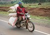 Man on motor bike with a full load on the road to Lake Nakuru Photo by Joe Saltiel