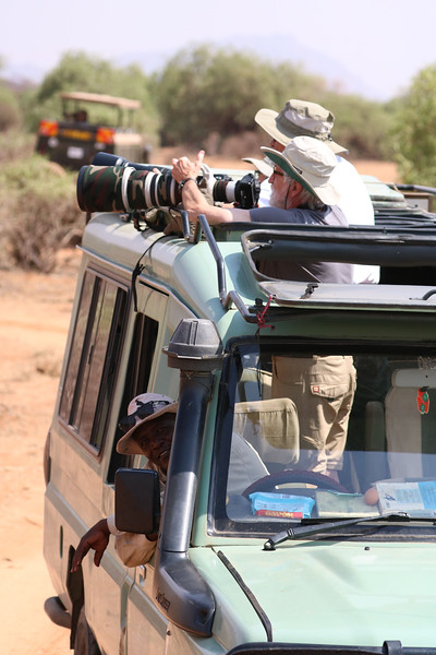 These were our safari jeeps. The tour leader, Robert, is the one wrestling the huge lens. He is a professional photographer and has some impressive equipment. The person driving the jeep is one of our guides, Zack.  Photo by Leah Bensen