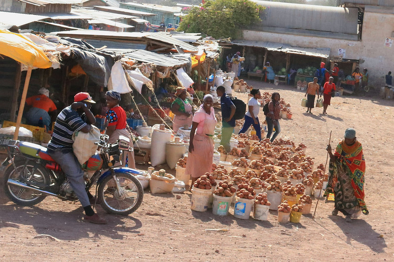 We passed a number of ismall kiosks along the road selling a few food or cloth items but periodically we would see a larger outdoor marketplace like this one  Photo by Leah Bensen