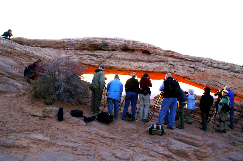 Group at Mesa Arch by Dave Milne